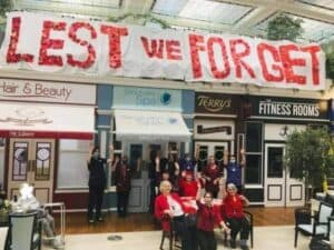 Care village create poppy banner to remember the fallen